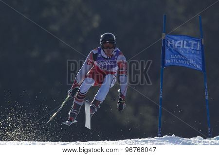 GARMISCH PARTENKIRCHEN, GERMANY. Feb 12 2011: Michal Klusak (POL) takes to the air competing in the men's downhill at the 2011 Alpine skiing World Championships