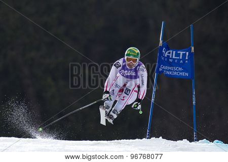GARMISCH PARTENKIRCHEN, GERMANY. Feb 12 2011: Klaus Kroell (AUT) takes to the air competing in the men's downhill at the 2011 Alpine skiing World Championships