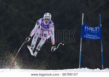 GARMISCH PARTENKIRCHEN, GERMANY. Feb 12 2011: Romed Baumann (AUT) takes to the air competing in the men's downhill at the 2011 Alpine skiing World Championships