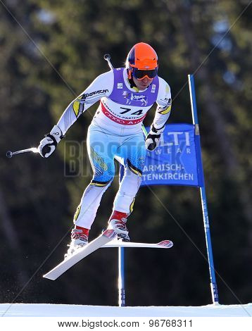 GARMISCH PARTENKIRCHEN, GERMANY. Feb 10 2011: Alexey Telminov (KAZ) takes to the air competing in the men's downhill training at the 2011 Alpine Skiing World Championships