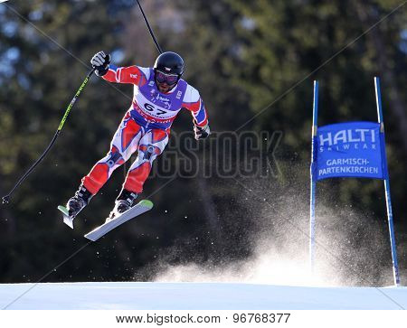 GARMISCH PARTENKIRCHEN, GERMANY. Feb 10 2011: Martin Vrablik (CZE) takes to the air competing in the men's downhill training at the 2011 Alpine Skiing World Championships
