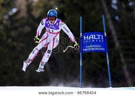GARMISCH PARTENKIRCHEN, GERMANY. Feb 10 2011: Benjamin Raich (AUT) takes to the air competing in the men's downhill training at the 2011 Alpine Skiing World Championships