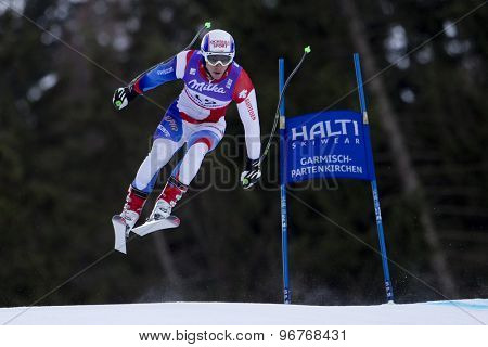 GARMISCH PARTENKIRCHEN, GERMANY. Feb 10 2011: Carlo Janka (SUI) takes to the air competing in the men's downhill training at the 2011 Alpine Skiing World Championships