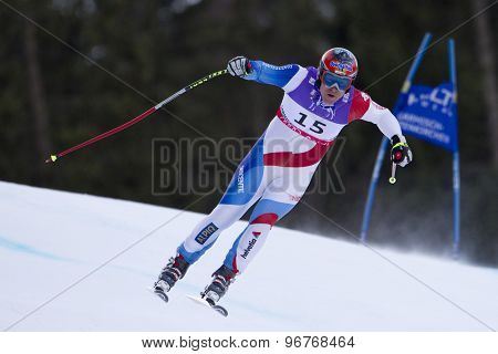GARMISCH PARTENKIRCHEN, GERMANY. Feb 10 2011: Didier Cuche (SUI) takes to the air competing in the men's downhill training at the 2011 Alpine Skiing World Championships
