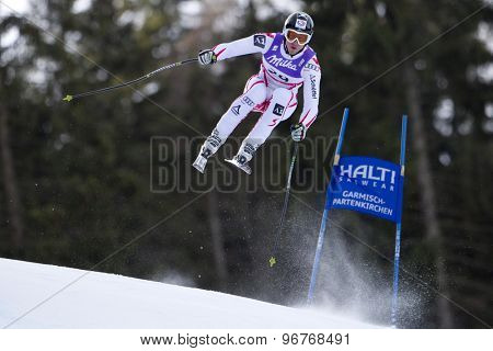 GARMISCH PARTENKIRCHEN, GERMANY. Feb 10 2011: Hannes Reichelt (AUT) takes to the air competing in the men's downhill training at the 2011 Alpine Skiing World Championships