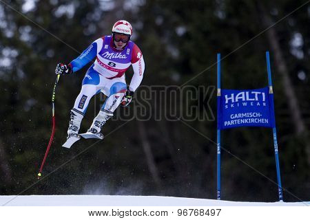 GARMISCH PARTENKIRCHEN, GERMANY. Feb 10 2011: Beat Feuz (SUI) takes to the air competing in the men's downhill training at the 2011 Alpine Skiing World Championships