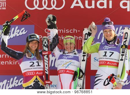 GARMISCH PARTENKIRCHEN, GERMANY. Feb 08 2011: Julia Mancuso second placed racer (L) Elisabeth Goergl (AUT) (C)  and Maria Riesch (GER) (R) on the podium at the 2011 Alpine skiing World Championships
