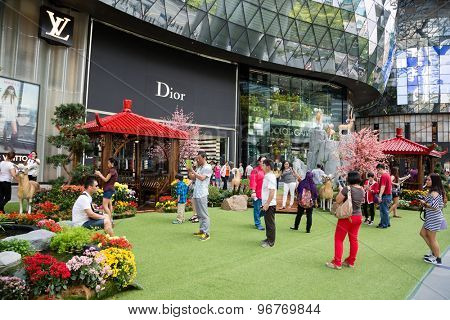 SINGAPORE - CIRCA FEBRUARY, 2015: People relax in the entertainment area at the mall ION Orchard - one the best shopping centers on Orchard Road. In the mall more than 300 shops of the famous brands.