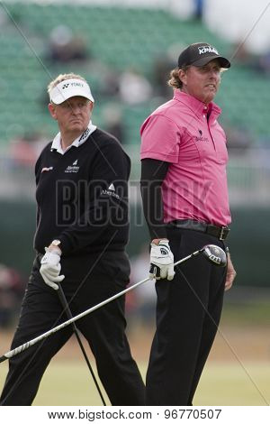 ST ANDREWS, SCOTLAND. July 15 2010: Colin MONTGOMERIE from Scotland (L) and Phil MICKELSON from USA (R) in action on the first day of The Open Championship   played on The Royal and Ancient Old Course