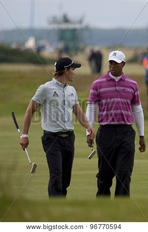 ST ANDREWS, SCOTLAND. July 15 2010: Camilo VILLEGAS from Colombia and Tiger WOODS from the USA in action on the first day of The Open Championship   played on The Royal and Ancient Old Course