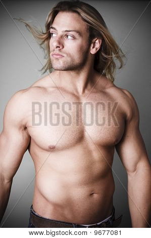 Muscular Man Measuring His Waist