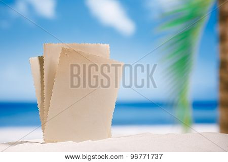 blank retro vintage photo on white sand beach, sky and seascape, shallow dof