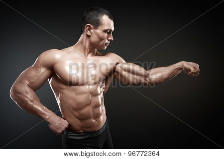 Strong And Handsome Young Bodybuilder Demonstrate His Muscles And Biceps