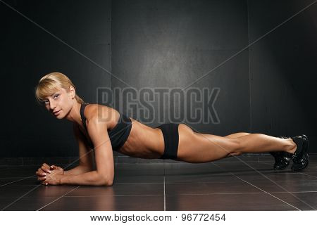 Fit Sportive  Woman Doing Plank Core Exercise