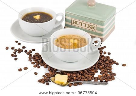 Black coffee and milk coffee with added butter served on cup and saucer