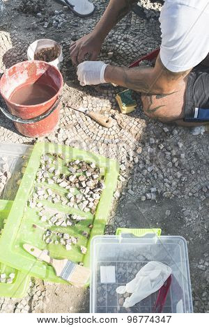 Archaeologists Recover Artifacts Mosaic.
