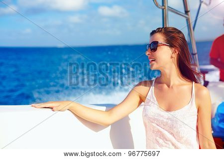 Happy Young Girl Enjoys Summer Vacation In Ocean Cruise On Powerboat