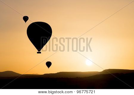 Hot air balloons fly over Cappadocia.