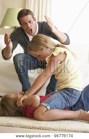Children Fighting In Front Of Father At Home