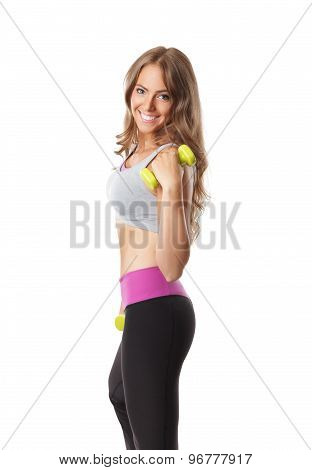 Slim Happy Woman Lifting A Dumbbell