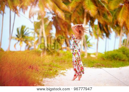 Beautiful Happy Girl Enjoy Summer Vacation In Tropical Palm Grove