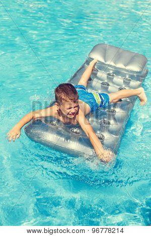 Little Boy Playing On Air Mattress