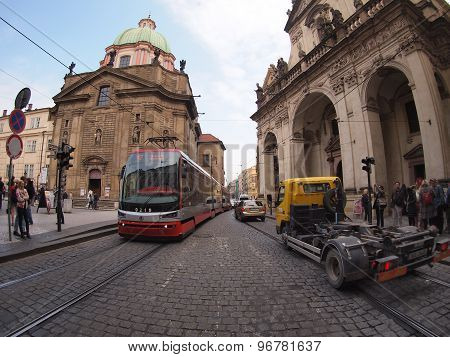 Tram On The Tram Rails And Trucks On The Narrow Streets Of Prague