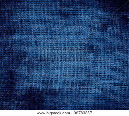Grunge background of dark cerulean burlap texture