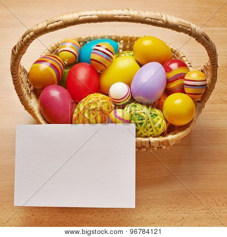 White card next to a basket of eggs