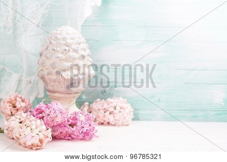 Background With Fresh Flowers Hyacinths And Decorative Cone