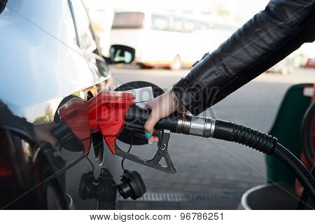 Woman Refueling Her Car In A Gas Station