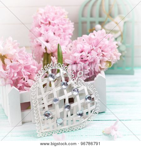 Heart And  Pink Flowers On Wooden Background