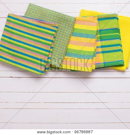 Yellow  Kitchen Towels  On White Wooden Background.