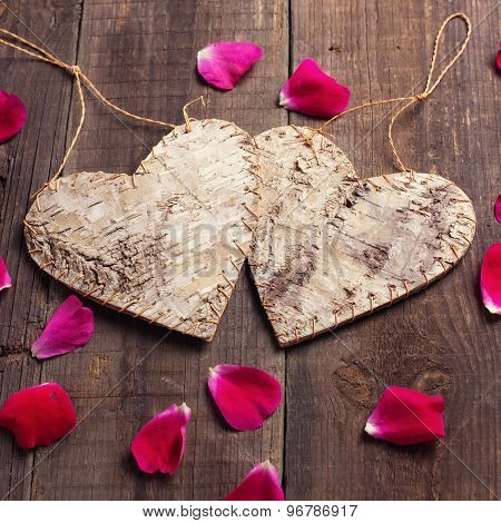 Hearts And Rose Petals On Wooden Background