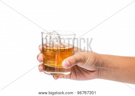 Hand holding a glass of whiskey on the rocks against white background
