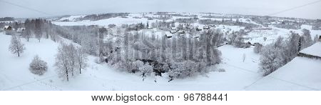 Russian winter. Snow-covered landscape with the village of Kruppsk next to the Izborsk Fortress near Pskov, Russia.