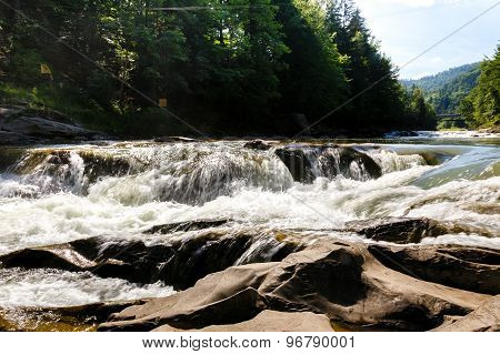 Mountain River Flows Between Stones