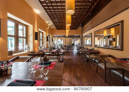 Cafe Restaurant Interior With Wooden Furniture, Lighting Equipment And Decoration.