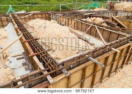 Foundation, pillar and beam being constructed at construction site