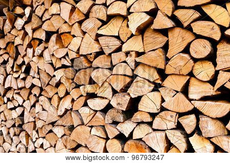 Minced Wooden Logs Stacked In The Woodpile