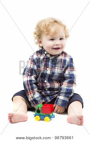Funny Baby Boy Playing With Toy