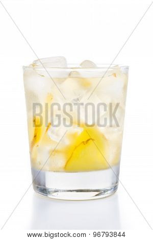 Refreshing ice cold ginger tea with straw in transparent glass