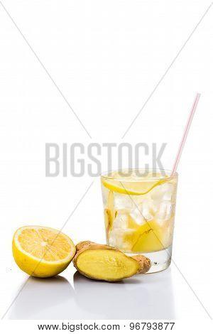 Refreshing ice cold ginger lemon tea in transparent glass in vertical format