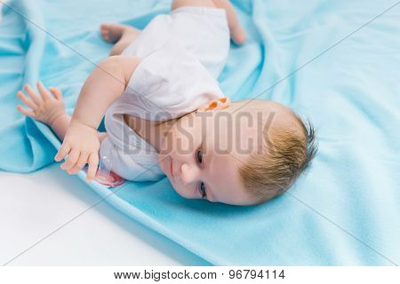 Baby Lying On A Blue Blanket