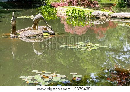Stone Birds In Green Pond