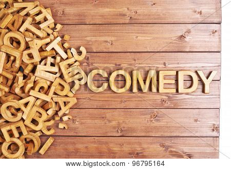 Word comedy made with wooden letters