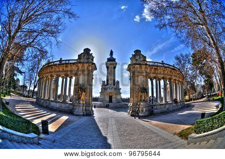 Hdr Image - Halo Of The Sun Over The Back Of The Monument To King Alfonso Xii In Retiro Park - A Lar