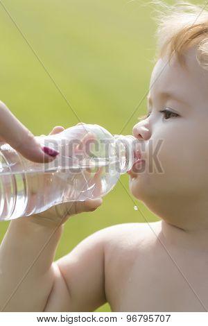 Little Boy Drinking Water From Bottle