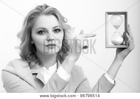 Business Woman Showing On Sand Glass