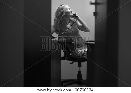Happy Female Secretary With Phone